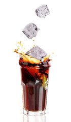 Glass of cola splashing, isolated on white background
