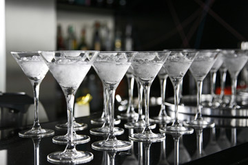 Classical martini in chilled glass over black background on