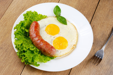 Fried eggs with sausage