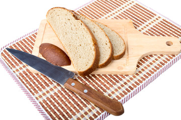Slices of bread  knife chopping board