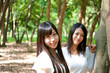 beautiful asian women in the forest