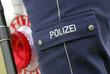 Polizeikelle mit Polizist bei Kontrolle