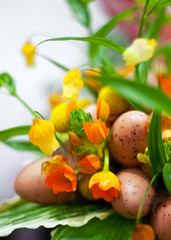 Flowers with wild bird eggs composition