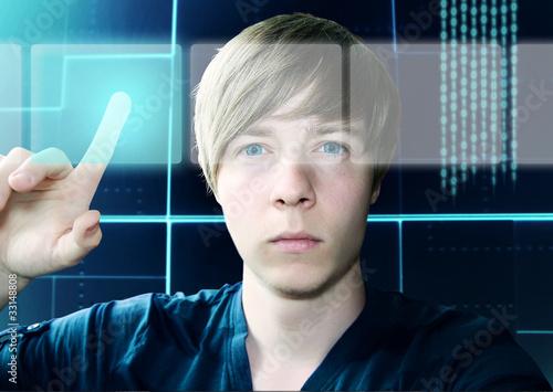 Leinwandbild Motiv Young Man and Touchscreen Interface