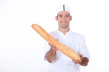 Baker showing off his bread