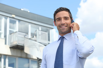 Businessman on mobile telephone