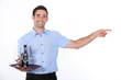 Waiter holding tray with beef bottle on it