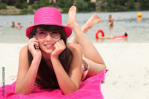smiling 20 years old Asian girl relaxing on the beach