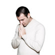 Man praying with hands clasped