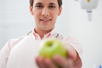 Man in dentist's office holding apple