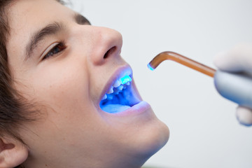Boy receiving dental bleaching