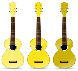 set of yellow classical acoustic guitar isolated on white