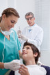 Dentist preparing for treatment