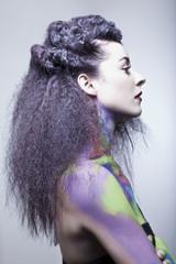 brunette model in studio with body paint