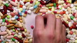 Hand clearing space in stack of pills