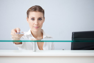 Receptionist holding health insurance card