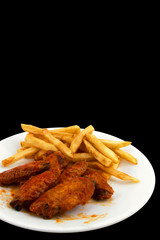 Hot Wings and Fries with a Black Background