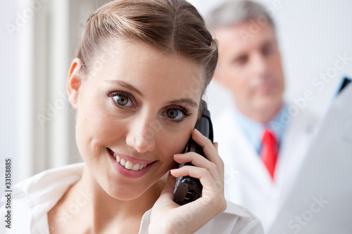 Assistant on the phone at the doctor's office