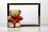 Teddybär mit Bilderrahmen