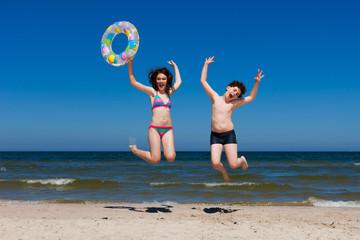 Kids jumping on beach