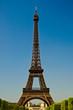 Leinwanddruck Bild - Eiffel Tower in portrait orientation with blue sky