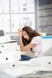 Young girl having headache in office
