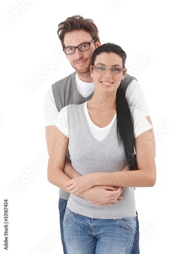 Happy young couple hugging each other