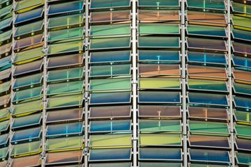 Colourful glass facade of a parking garage