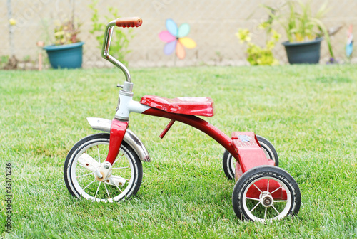Old Red Kids Bike on The Grass