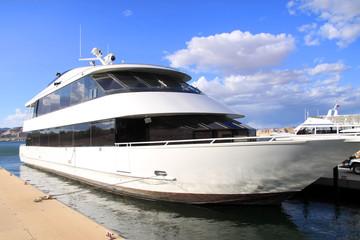 Luxury yacht at marina on a sunny day