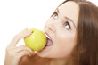 Pretty girl with open mouth eating green ripe apple