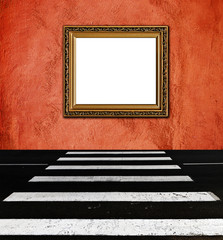 old  elegant golden frame on peach plaster rough background pede