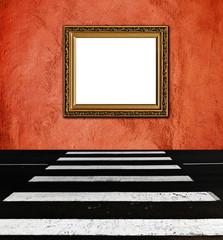 old  elegant golden frame on peach plaster rough background pede