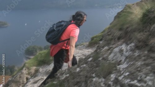 Woman climbing up mountain