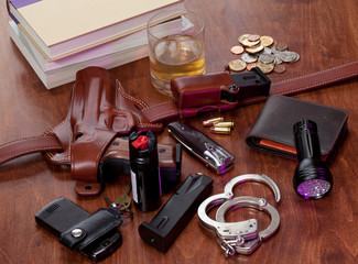 Police officer's equipment on bedside table