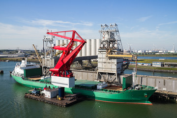 Grain elevator with terminal, cranes and ship