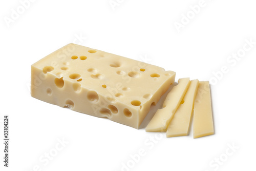 Piece of Emmentaler cheese and slices
