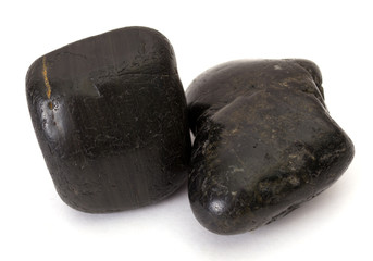 Two black stones isolated on white background