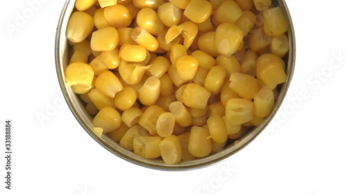 Spinning opened sweetcorn tin