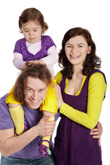 Father, mother and daughter, daughter sits on father's shoulder