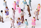 miniature toy people stand in different poses