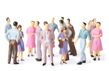 toy people stand in different poses isolated