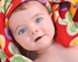 Surprised Baby in Red Blanket