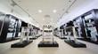 Leinwandbild Motiv Black selves with many boots and shoes into large shoe store