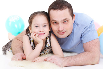 father plays with the daughter. It is isolated