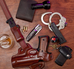 Police equipment on a table with alcoholic beverage