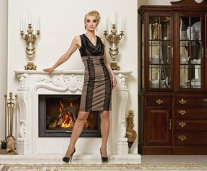 Beautiful blond woman in a luxury interior