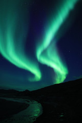 Aurora moving along the horizon