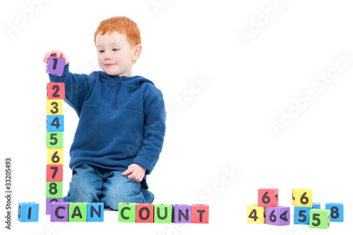 Boy counting numbers with kids blocks