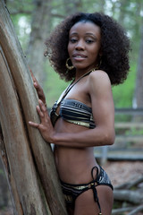 Pretty black woman in bathing suit outside